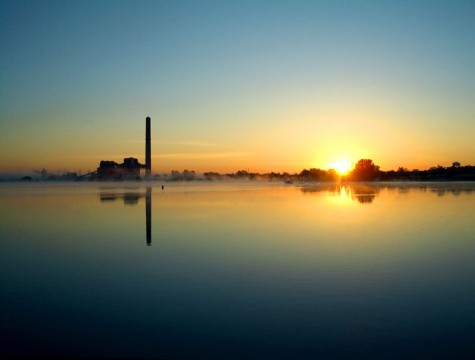 The sun rises behind Muskegon's BC Cobb power plant on the morning of May 23, 2006