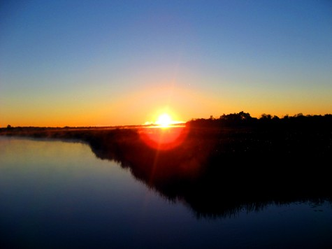 Watching the sunrise from an old railroad bridge over the Muskegon River on October 6, 2006