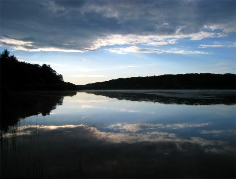 Rain clouds and their reflections frame the eastern shore of Muskegon County's Duck Lake on June 22, 2008