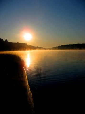 A misty sunrise at Muskegon County\'s Duck Lake State Park on July 6, 2007