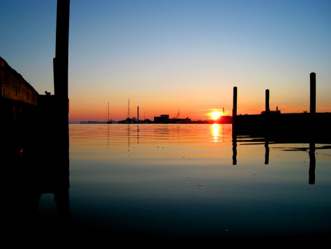 The boat docks at the Hartshorn launch frame the sunrise over Muskegon on June 23, 2008