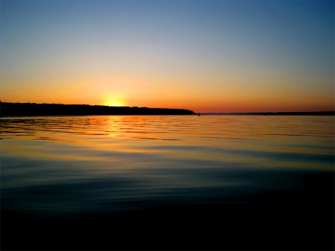 The summer solstice sun rises over Muskegon County\'s White Lake on June 20, 2008