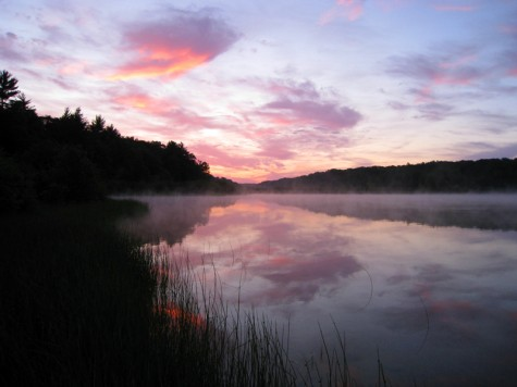 Dawn breaks over the eastern shore of Muskegon County\'s Duck Lake on July 4, 2008