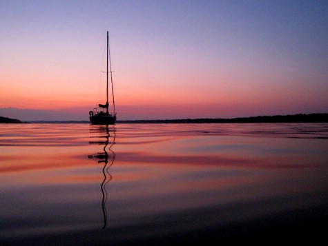An anchored sailboat early on the morning of August 1, 2008