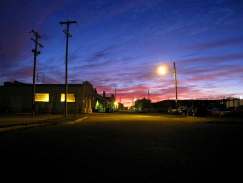 The sun rising over Muskegon's Western Avenue on October 17, 2008
