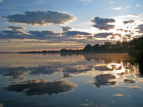 Clouds reflected in Muskegon Lake during the sunrise on July 6, 2009.