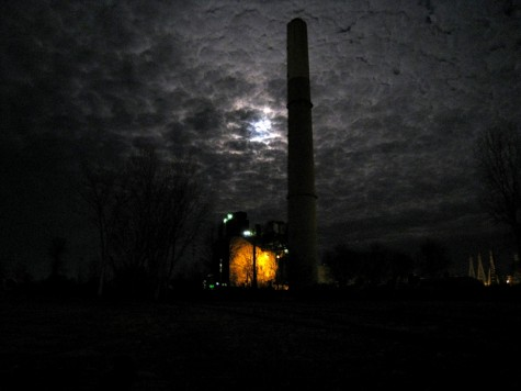 The full moon behind Muskegon's BC Cobb plant