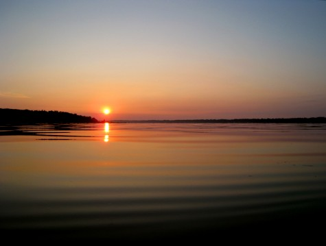 The sun rises over Muskegon County's White Lake on August 1, 2008