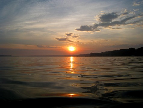 The sun rises over Muskegon County's White Lake on the morning of June 27, 2008